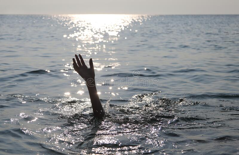 Hand of a drowned person stock photography