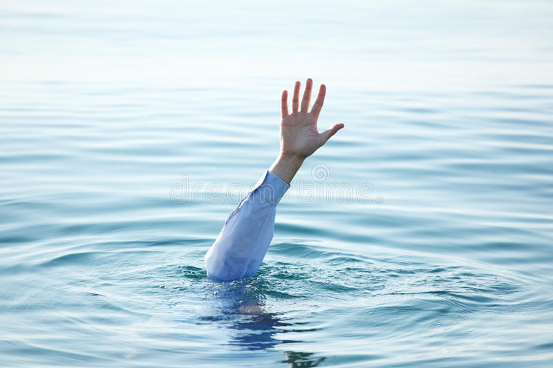 Hand of drowning man royalty free stock photography