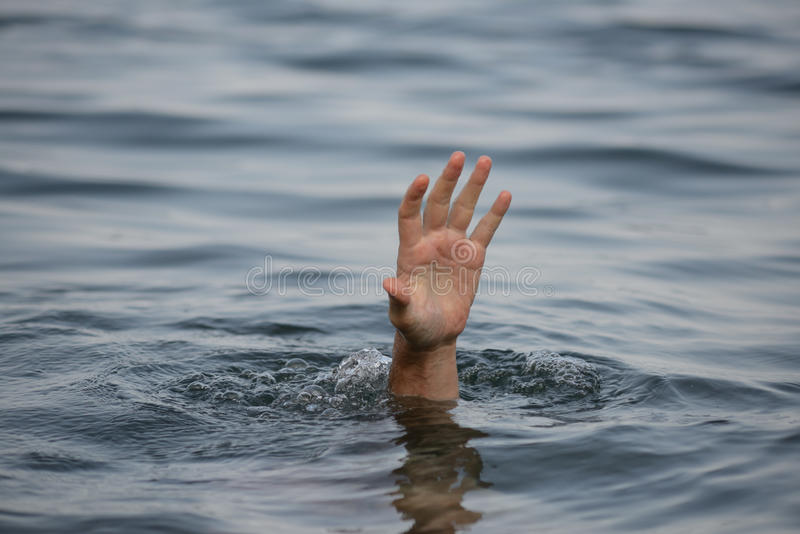 Hand drowning stock images