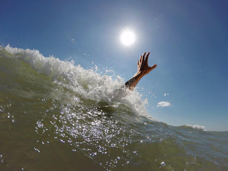 Hand drowning man stock photography