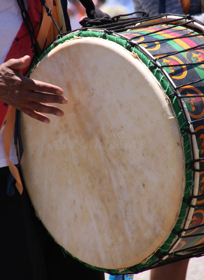 Hand drum. A man playing a bass hand drum royalty free stock images