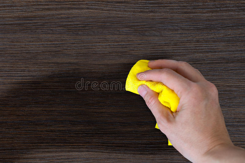 Hand dust the wood furniture. Hand with a rag to dust the wood furniture stock images