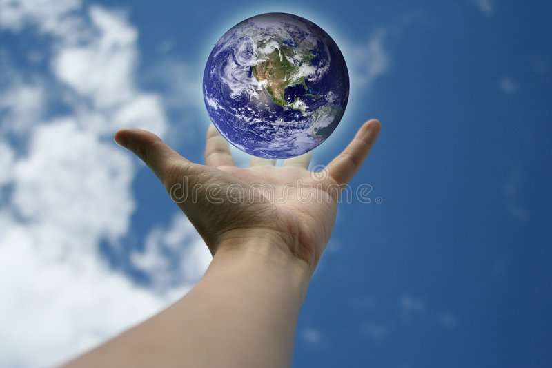 Hand and Earth stock photos