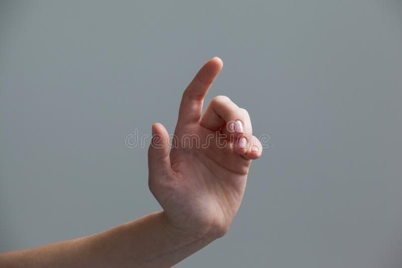 Hand einer Frau, die Gesten macht lizenzfreies stockfoto