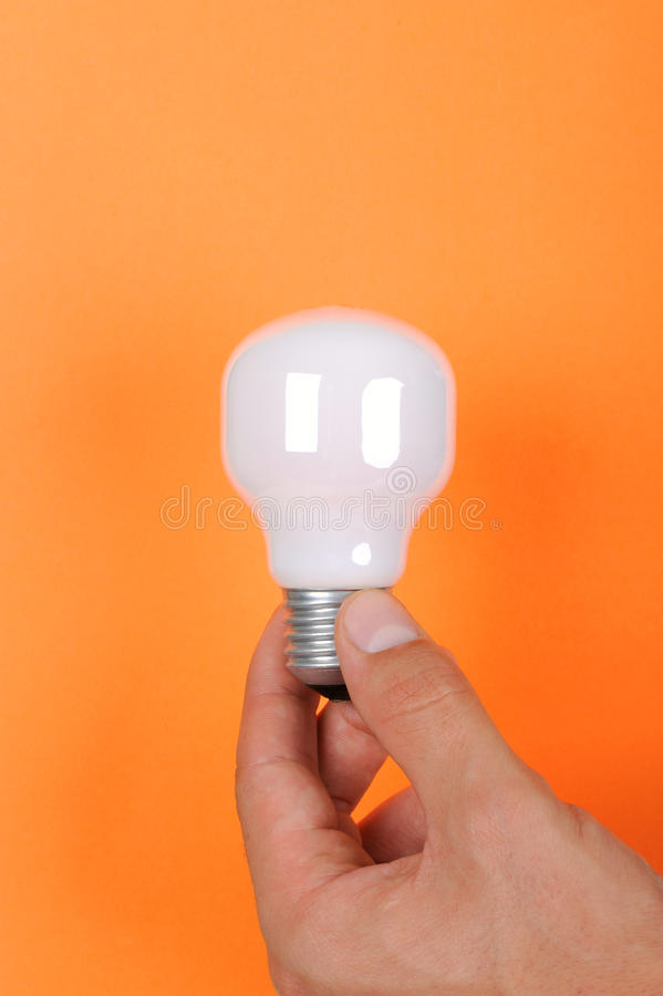 Hand and electric lamp royalty free stock images