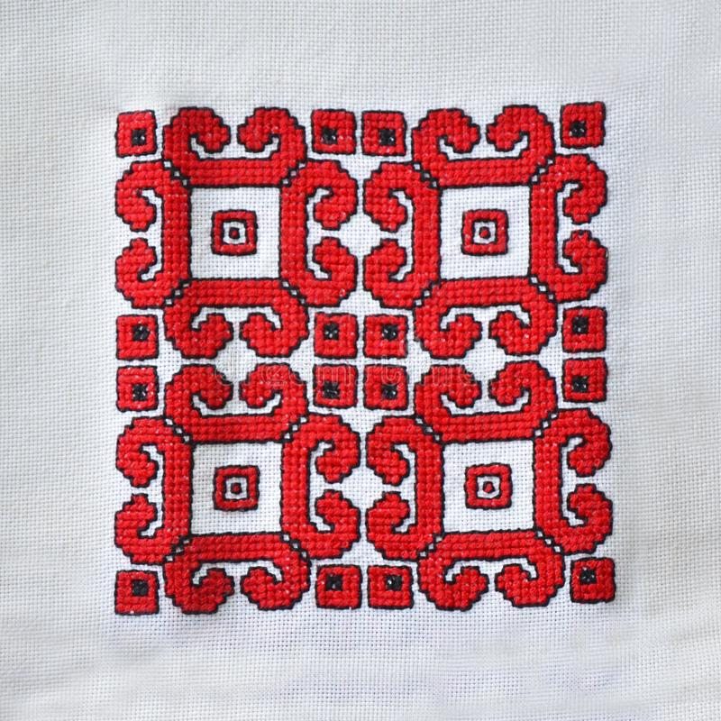 Hand embroidered tablecloth with traditional ethnic motifs. Embroidered on a white background. Background with ethnic motifs from Serbia royalty free stock images
