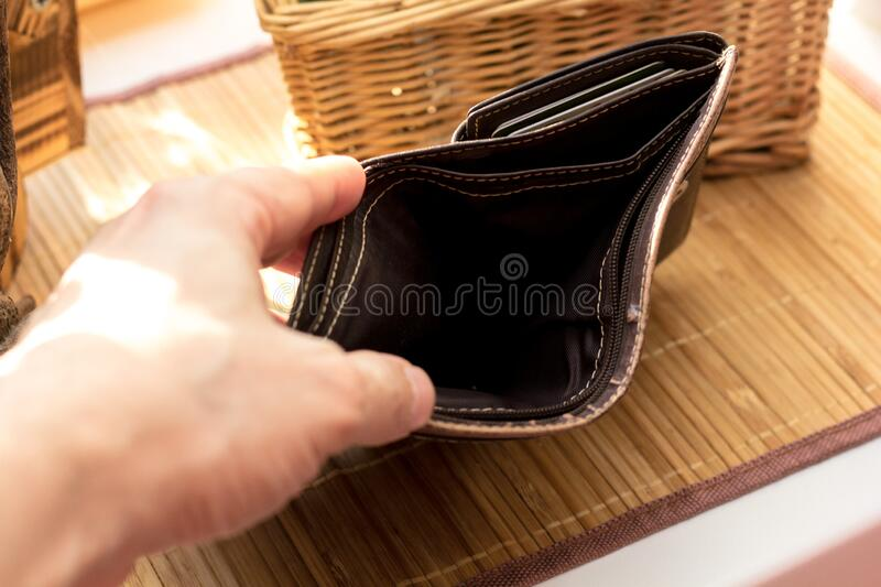 Hand with empty wallet royalty free stock photo