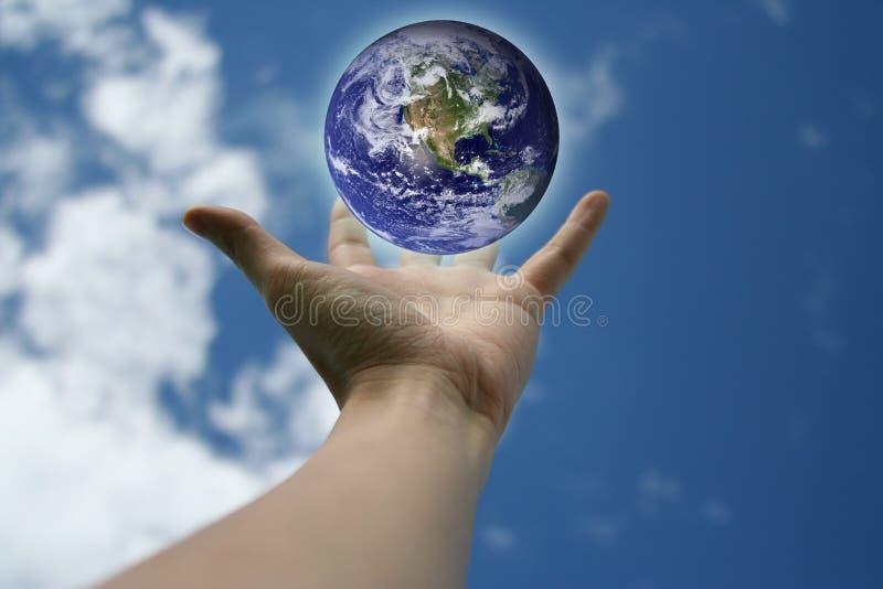 Hand en Aarde stock foto's