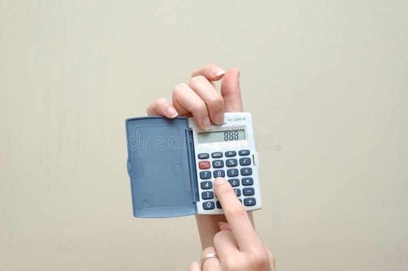 Hand en calculator royalty-vrije stock fotografie