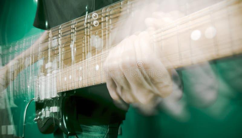 Hand en elektrische gitaar royalty-vrije stock afbeelding