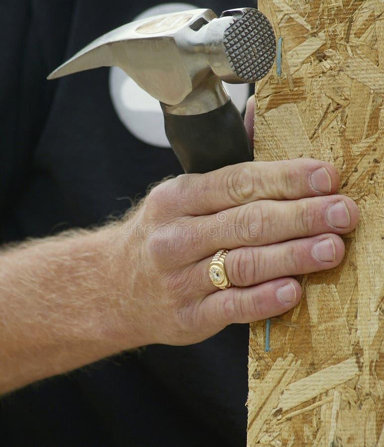 Hand en Hamer stock afbeeldingen