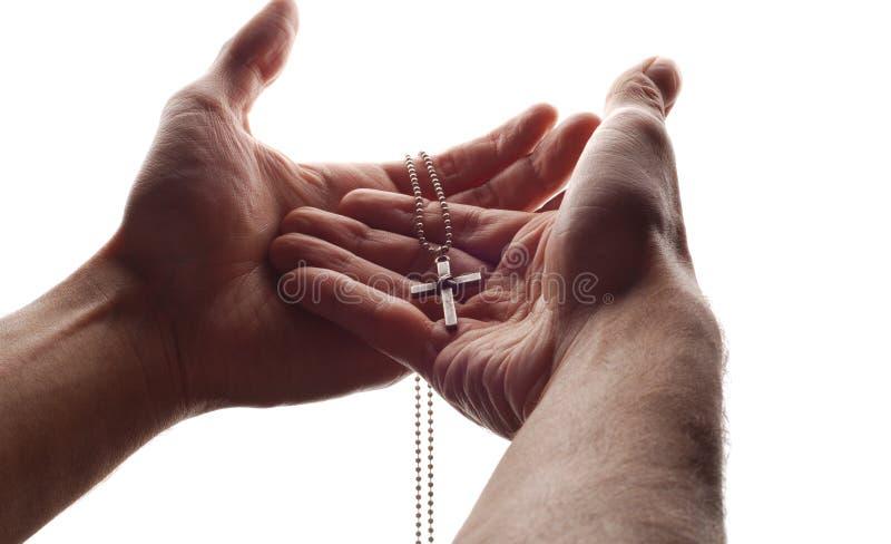 Hand en kruis royalty-vrije stock fotografie