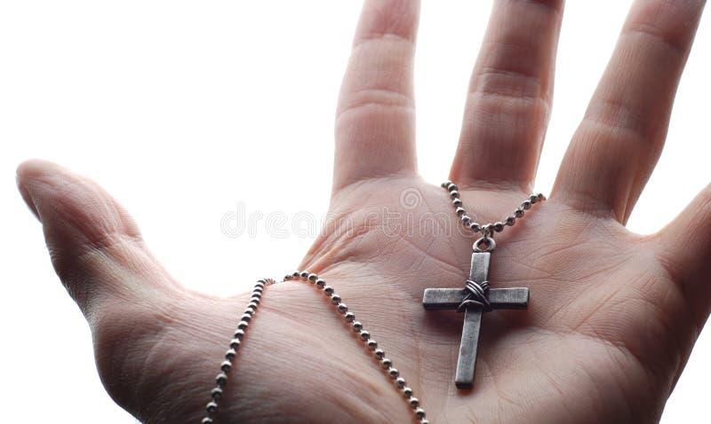 Hand en kruis stock foto's