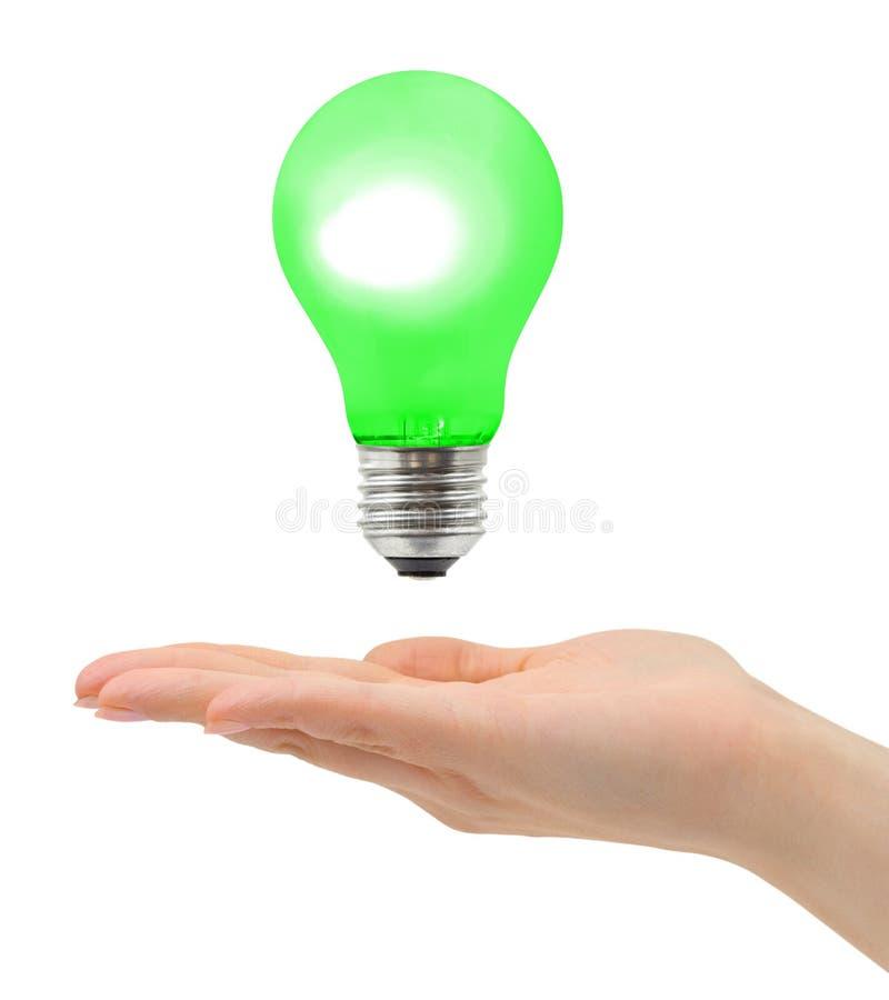 Hand en lamp stock foto