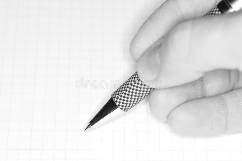 Hand en pen royalty-vrije stock afbeeldingen