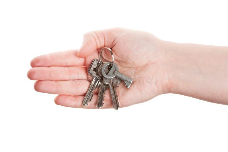 Hand en sleutels royalty-vrije stock fotografie