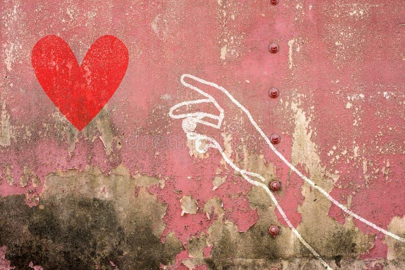 Hand en wapen die voor rood hart, hand bereiken die op bakstenen muur wordt getrokken royalty-vrije stock afbeelding