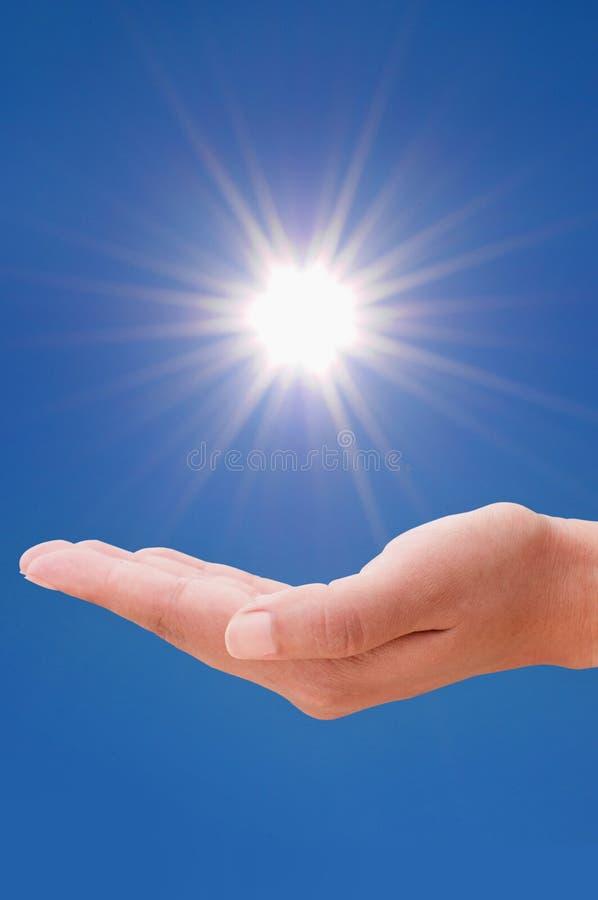 Hand en zon royalty-vrije stock afbeeldingen