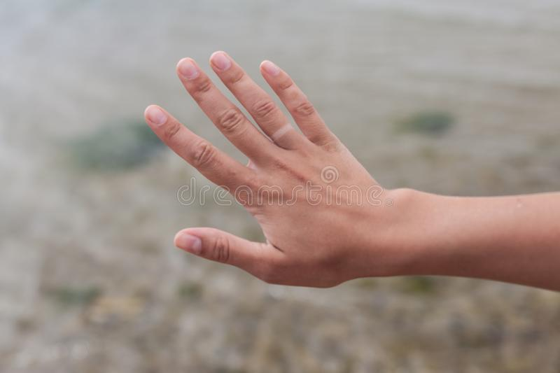 Hand without engagement ring with suntan. The girl took off the wedding ring on vacation that no one knew that she was married.  stock photos