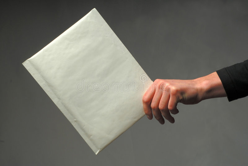 Hand with an envelope royalty free stock photography