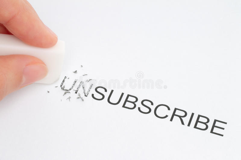 Hand erase part of the unsubscribe word stock photography