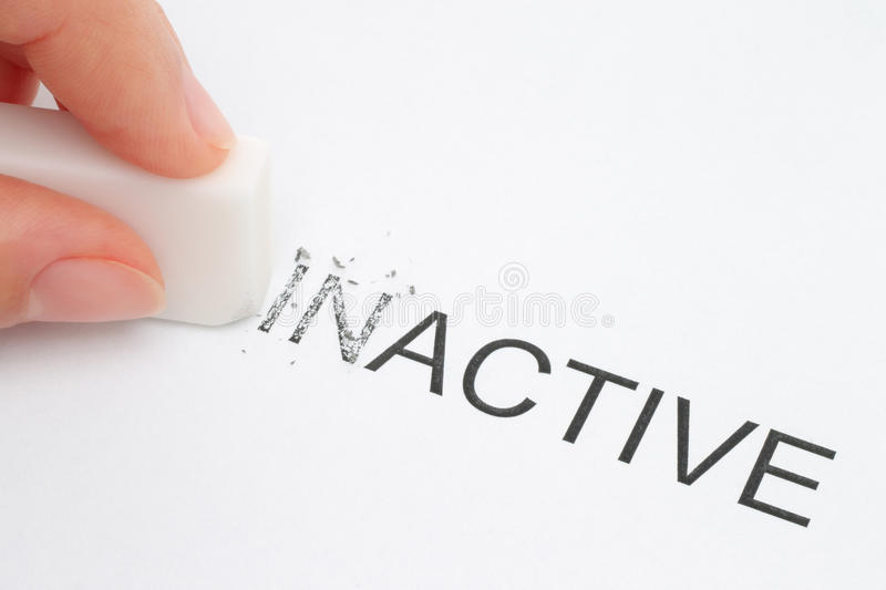Hand erasing part of the inactive word. Close-up stock images
