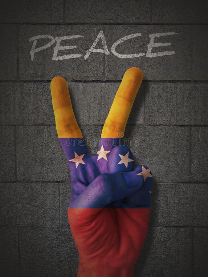 Hand för fredtecken med den Venezuela flaggan royaltyfria bilder