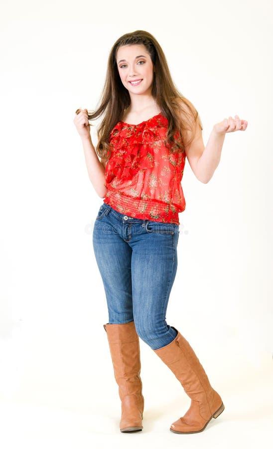 Hand för kropp för ung kvinna för stående som full snurrar hår royaltyfria foton