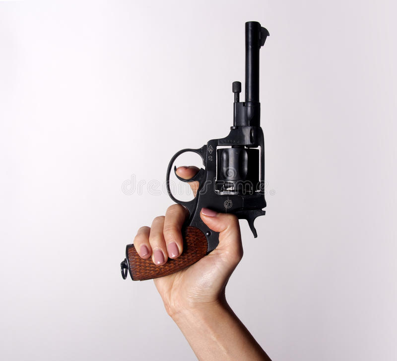 Hand för kvinna` s med ett vapen fotografering för bildbyråer