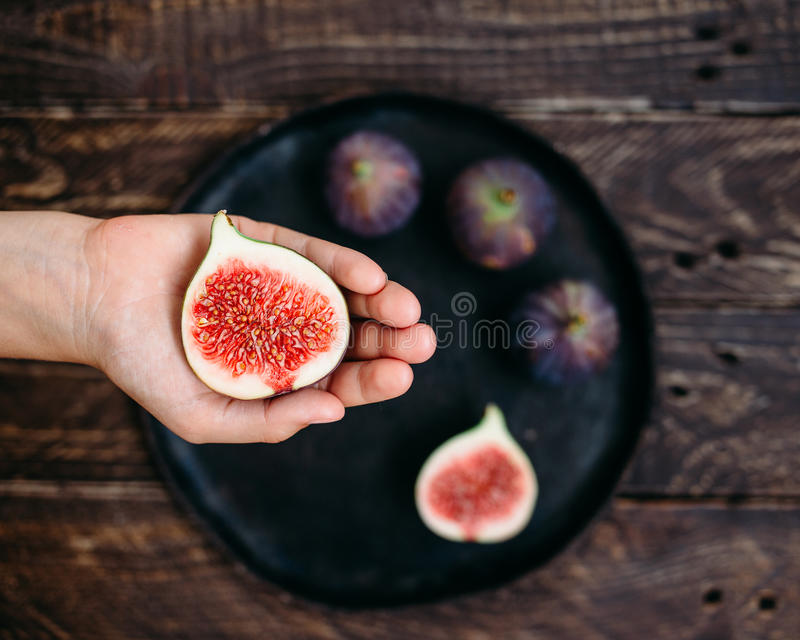 Hand with figs royalty free stock photos