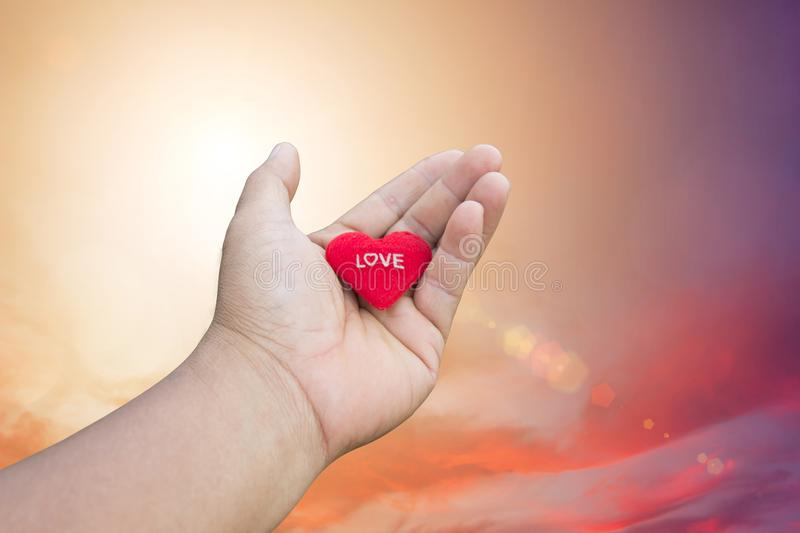 Hand is filing love lover or give Valentines gift under warm li stock photo
