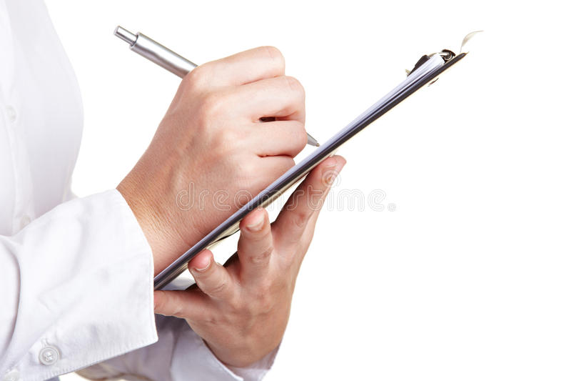 Hand filling out checklist on royalty free stock photo
