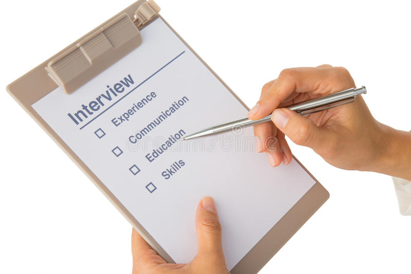 Hand fills out job interview checklist stock photos