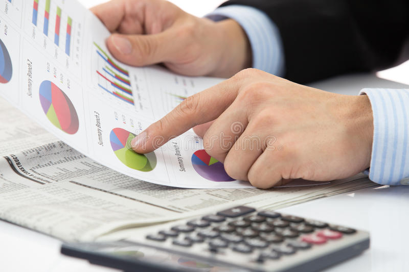 Hand with finance report stock image