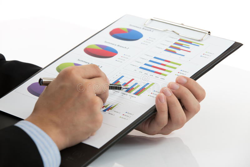 Hand with finance report stock photos