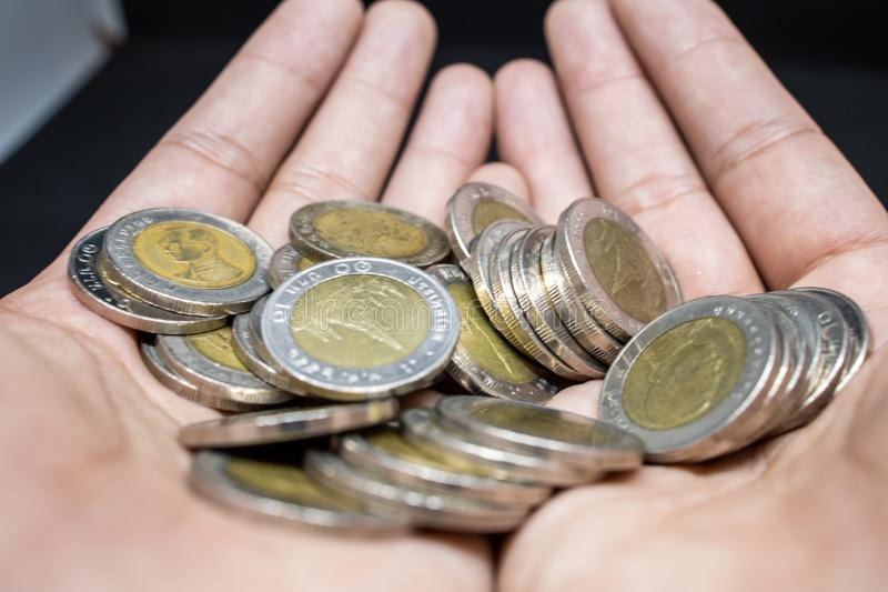 Hand on Thai Coin currency royalty free stock photo