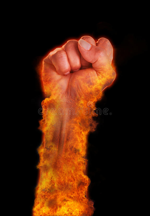Hand with fire burning on black background stock images