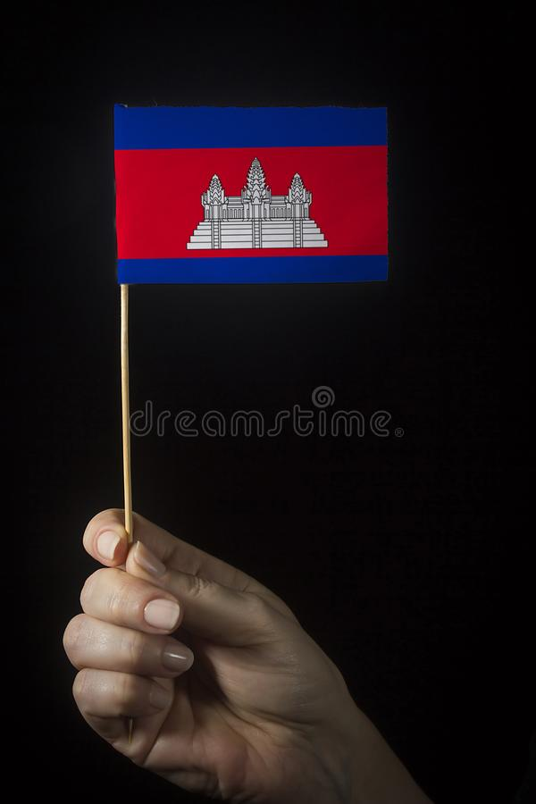 Hand with Flag of Cambodia royalty free stock image