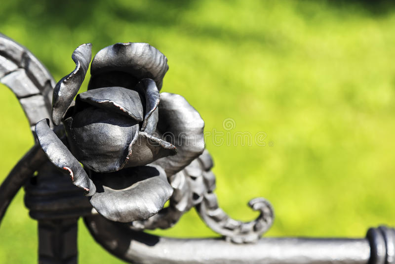Hand forged metal rose stock photo