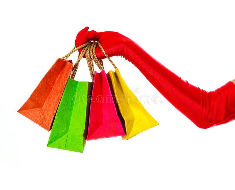 Hand With Four Shoppign Bags Stock Images