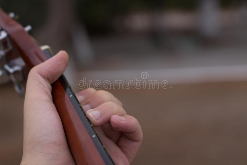 Hand and fretboard stock photo. Image of park, left - 101764924