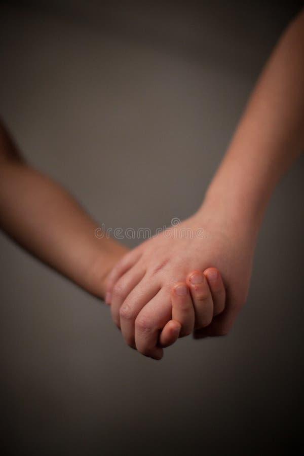 Hand in Hand Freundschaft stockfotografie