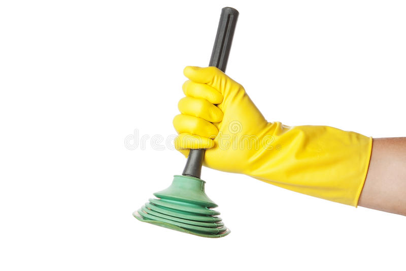 Hand in a gauntlet holdin gplunger. royalty free stock photo