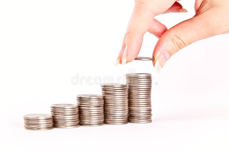 Hand gezet muntstuk aan geldtrap stock afbeeldingen