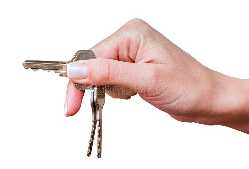 Hand of girl with keys from home or car on white isolated background_ stock photo