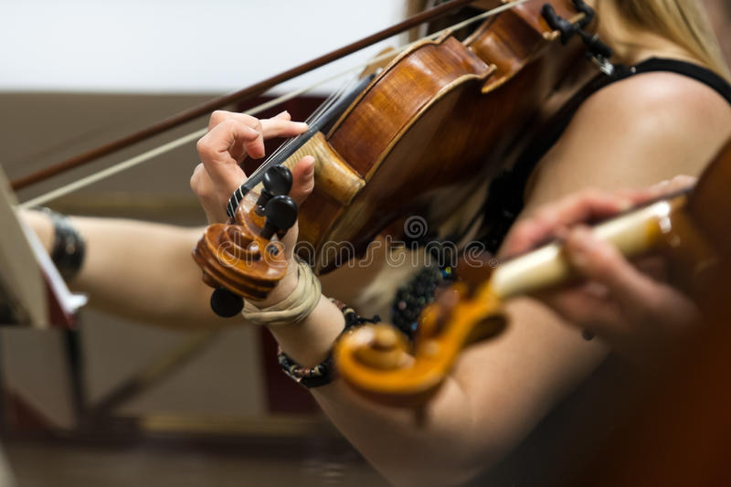 The hand of a girl playing the violin royalty free stock photos