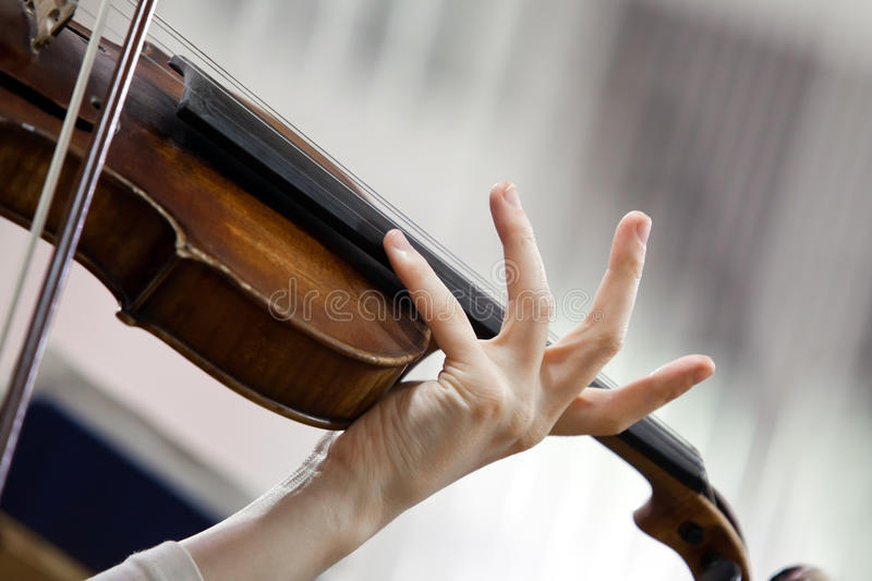 Hand girl playing the violin royalty free stock photos