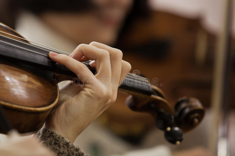Hand girl on the strings violin. Closeup royalty free stock photo