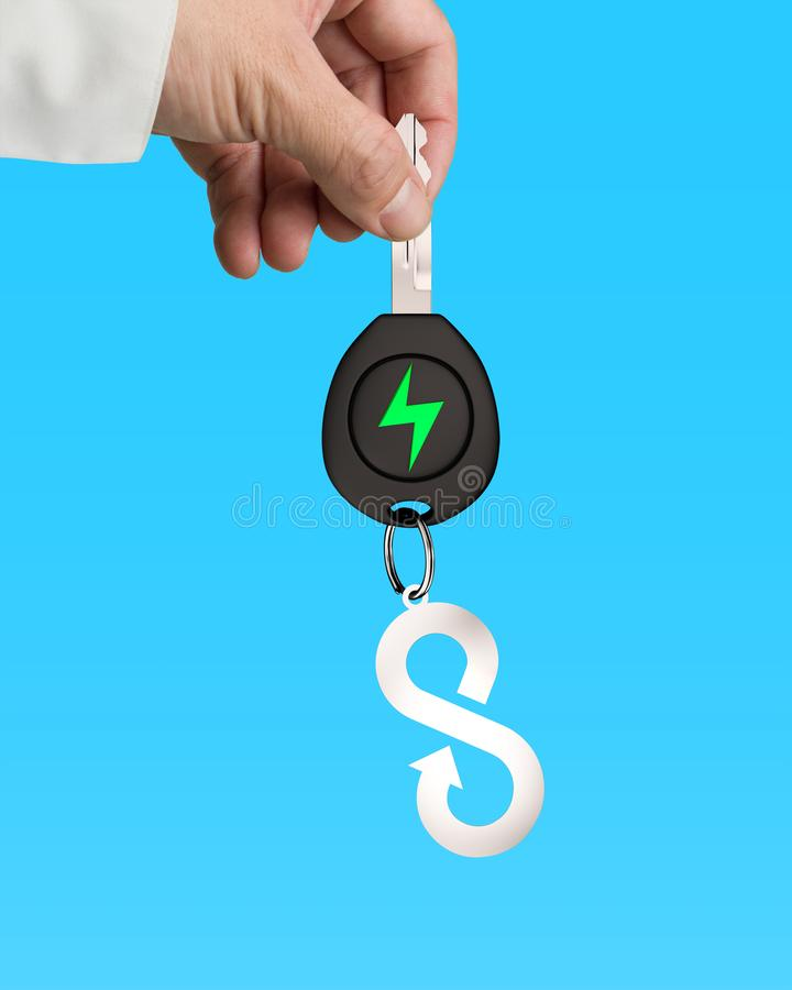 Hand give electric car key infinity arrow sheet metal keyring royalty free stock images