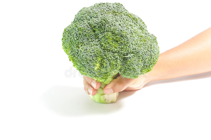 Hand Giving Green Broccoli Royalty Free Stock Image